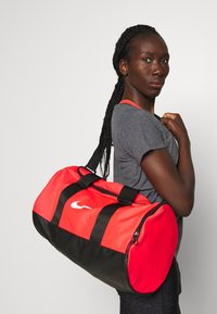 Nike Performance - TEAM DUFFLE - Sports bag - laser crimson/black/white - 1