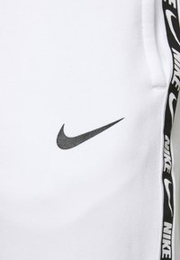 Nike Sportswear - REPEAT - Tracksuit bottoms - white/black - 5