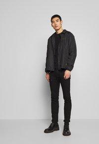 Belstaff - TEAMSTER JACKET PRINT - Summer jacket - black - 1