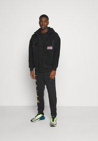 Jordan - Fleece jacket - black - 1