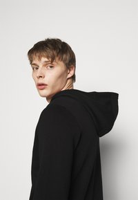 HUGO - DAPLE - Zip-up hoodie - black - 3