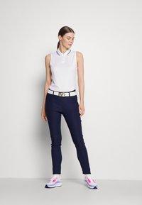Kjus - IKALA TREGGINS WARM - Outdoor trousers - atlanta blue - 1