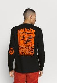 Carhartt WIP - INTERNATIONAL OPERATIONS  - Long sleeved top - black/orange - 2