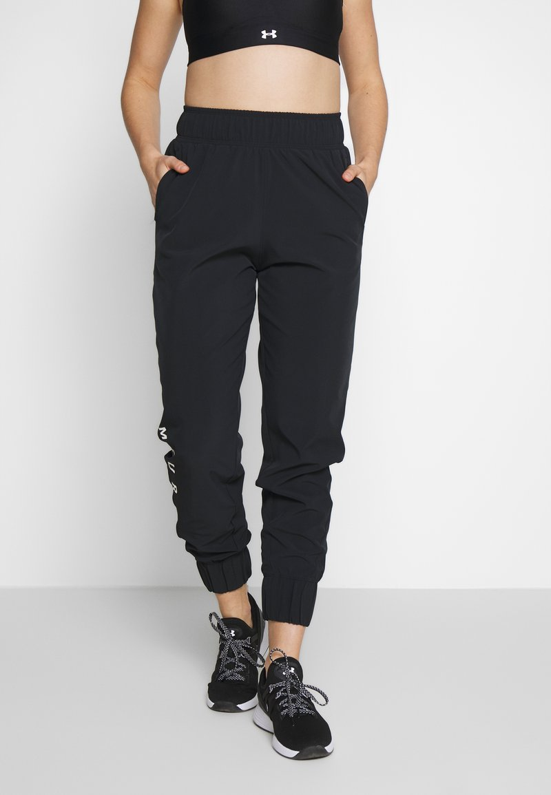Under Armour - GRAPHIC PANTS - Tracksuit bottoms - black/onyx white