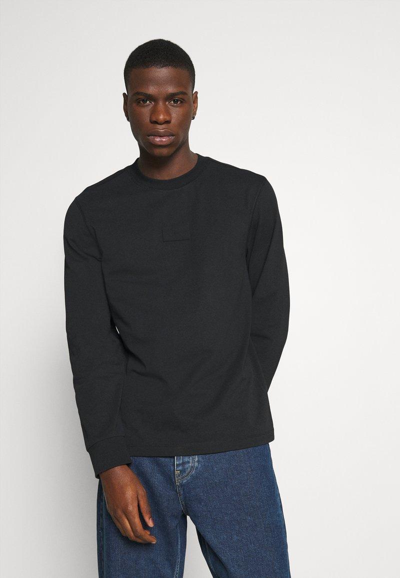 Calvin Klein Jeans - CENTER BADGE - Long sleeved top - black