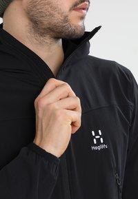 Haglöfs - NATRIX HOOD MEN - Soft shell jacket - true black - 3