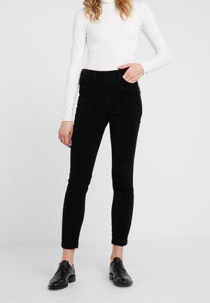 JEANETT - Trousers - black