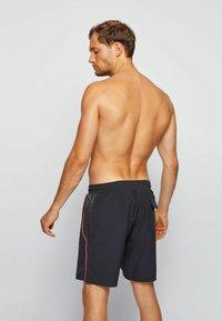 BOSS - Swimming shorts - black - 1