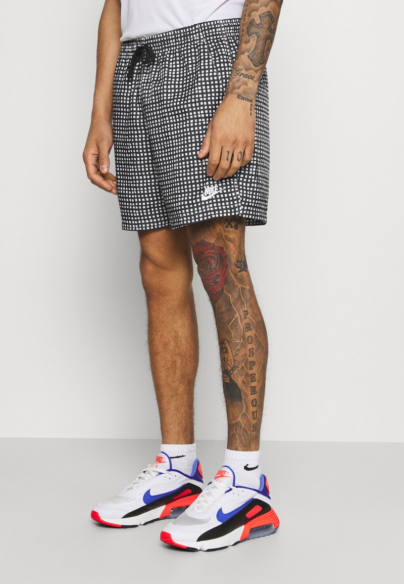Nike Sportswear - FLOW GRID - Shorts - black/white