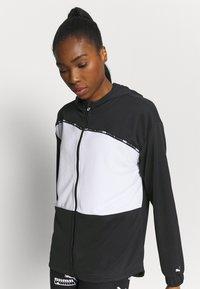 Puma - TRAIN LOGO ULTRA JACKET - Training jacket - black/white - 3