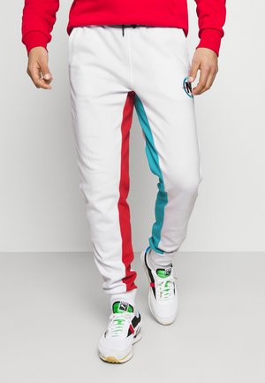 PARREL - Tracksuit bottoms - white