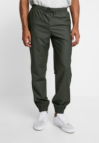 Rains - UNISEX TROUSERS - Trainingsbroek - green - 0