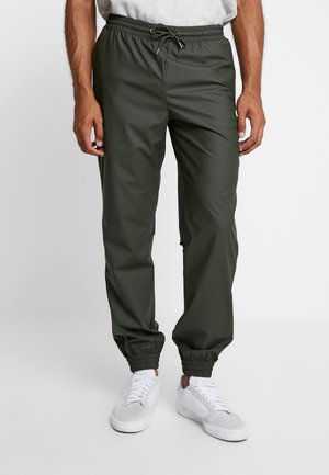 UNISEX TROUSERS - Trainingsbroek - green