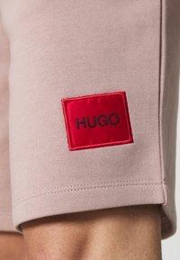 HUGO - Tracksuit bottoms - light brown - 5