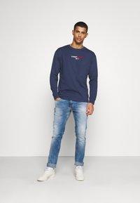 Tommy Jeans - AUSTIN SLIM - Slim fit jeans - wilson light blue stretch - 1