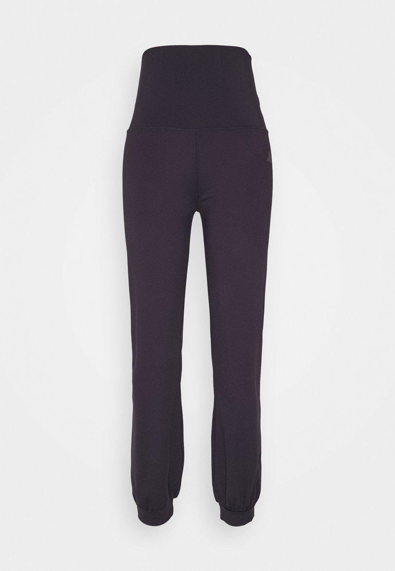 Curare Yogawear - LONG PANTS ROLL DOWN - Tracksuit bottoms - dark aubergine