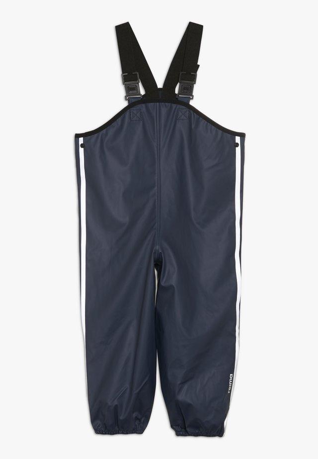 LAMMIKKO - Pantalones impermeables - navy