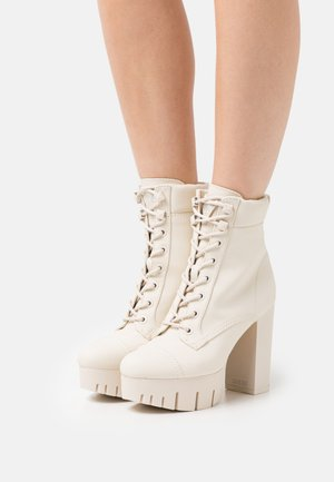 GEOVEY - Lace-up ankle boots - cream