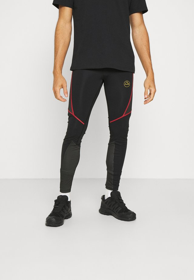 TRIUMPH PANT  - Leggings - black/yellow