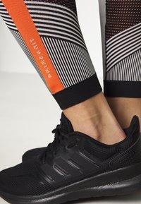 adidas Performance - PARLEY PRIMEKNIT RUNNING HIGH WAIST LEGGINGS - Leggings - black/white/orange - 3