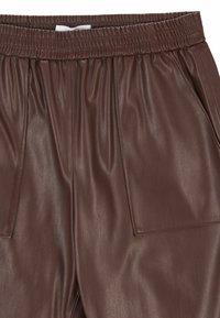 BOSS - TAJOGY - Pantalon de survêtement - dark brown - 5