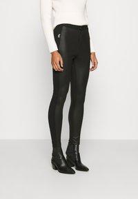 Calvin Klein Jeans - MOTO COATED MILANO  - Leggings - Trousers - black - 0