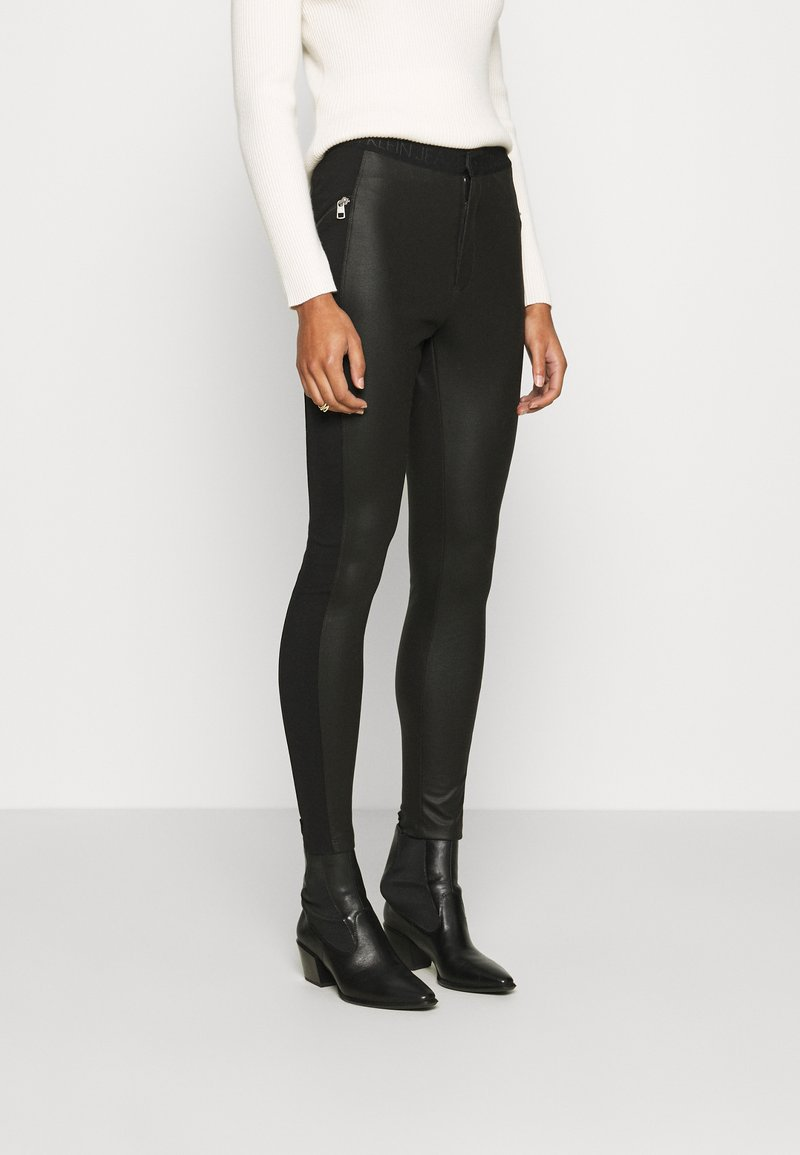 Calvin Klein Jeans - MOTO COATED MILANO  - Leggings - Trousers - black