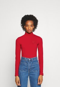 Tommy Hilfiger - ICON SLIM ROLL NECK - Long sleeved top - primary red - 0