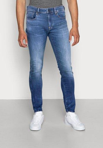 REVEND SKINNY - Slim fit jeans - medium indigo