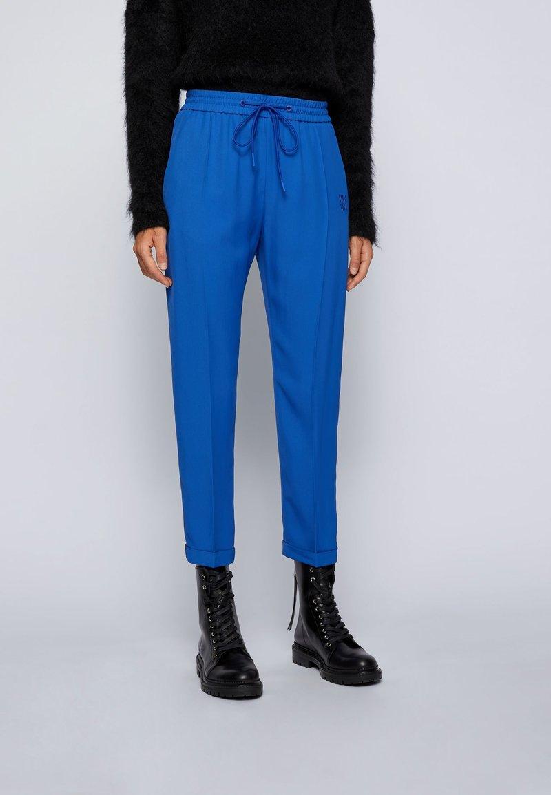 BOSS - Tracksuit bottoms - light blue