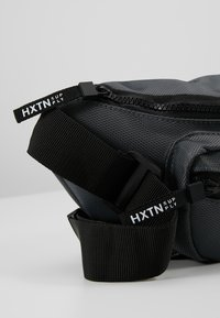 HXTN Supply - UTILITY TRANSPORTER BUM BAG - Bum bag - charcoal - 7