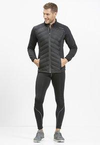 Endurance - MIT WARMER WINTERSTEPPUNG - Outdoor jacket - black - 1