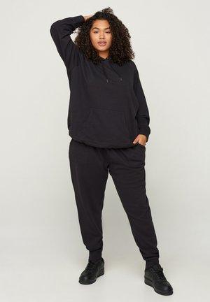MIT TASCHEN - Pantaloni sportivi - black