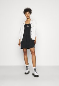 Hollister Co. - PRIDE CAPSULE EMBROID BABYDOLL DRESS - Jersey dress - black - 1