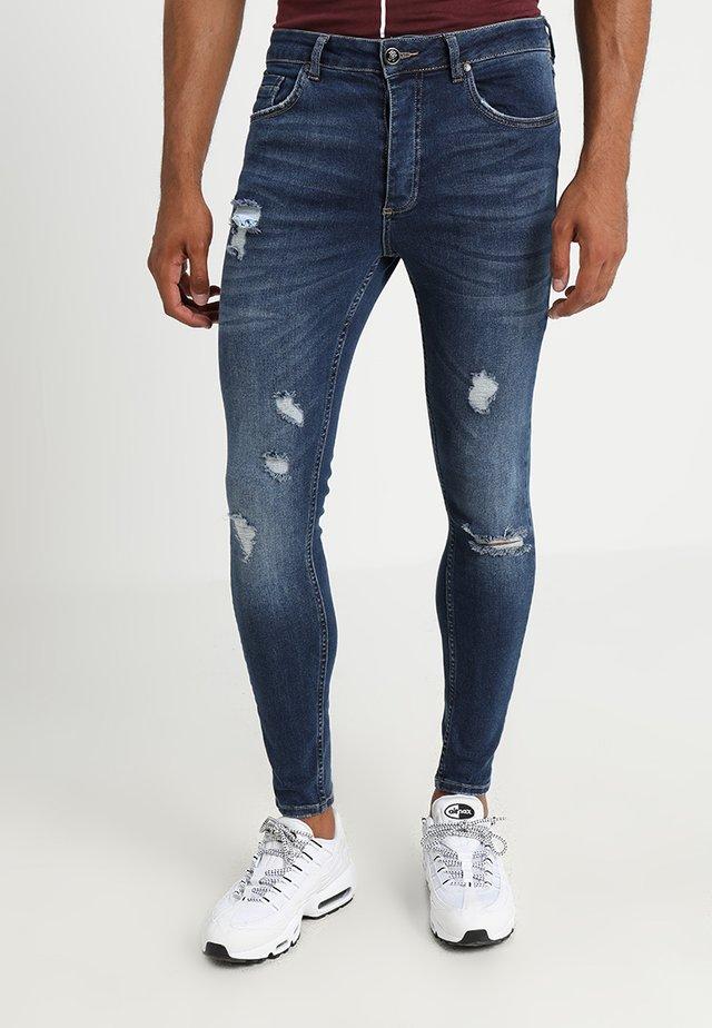 RIP AND REPAIR - Jeans Skinny Fit - indigo