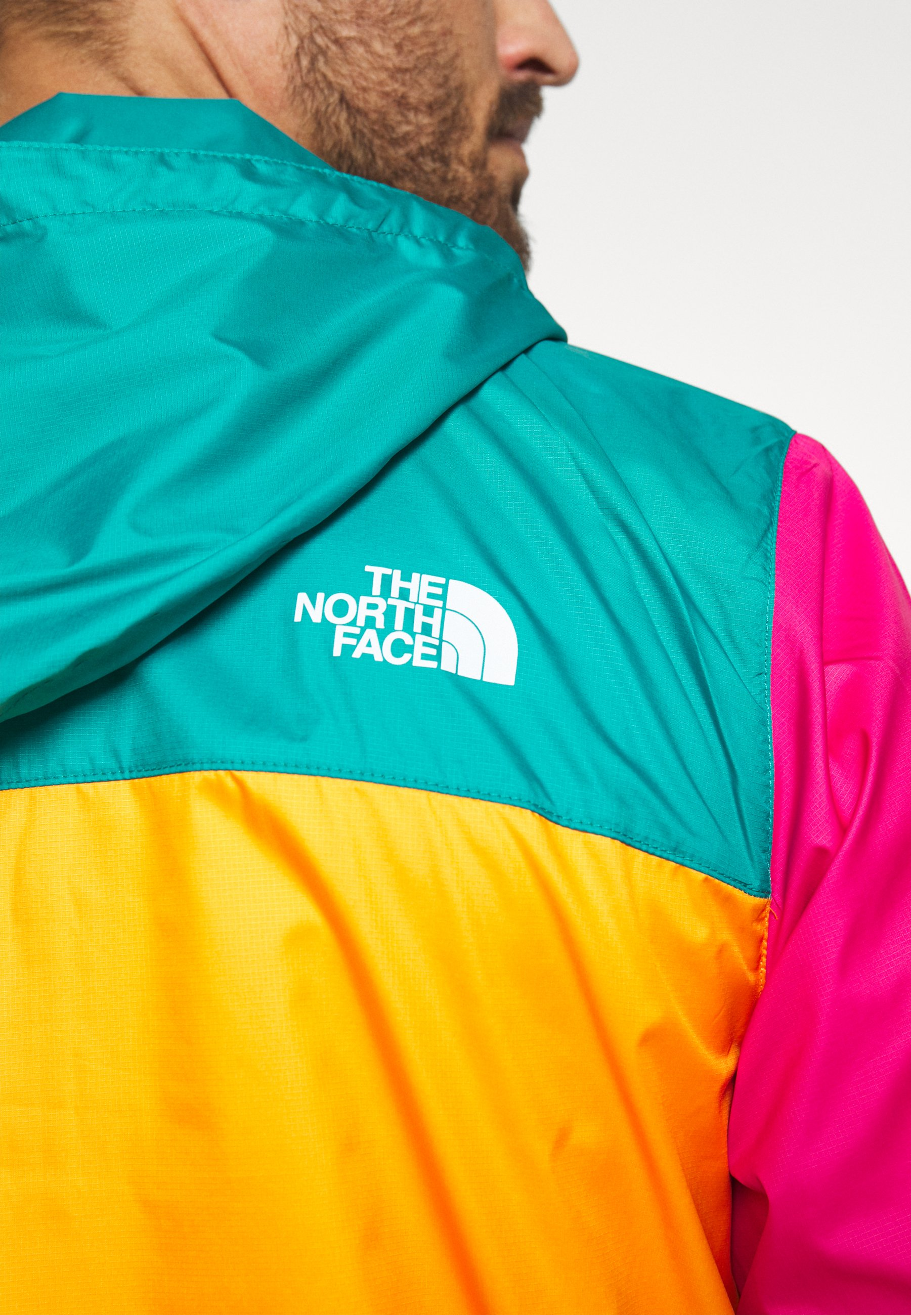 The North Face MENS FANORAK - Veste coupe-vent - orange/teal/pink