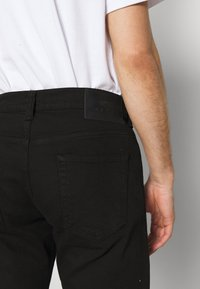 Edwin - TAPERED - Jeans Tapered Fit - black denim - 3