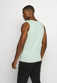 Nike Performance - DRY TANK SOLID - Sports shirt - pistachio frost - 2