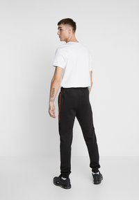Kings Will Dream - DEFLOUR JOGGERS WITH TAPING - Tracksuit bottoms - black - 2