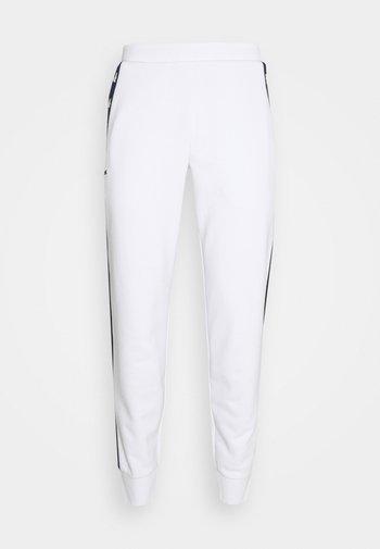 PANT TAPERED - Trainingsbroek - white/navy blue