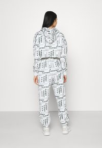Missguided - PLAYBOY LOGO JOGGER - Tracksuit bottoms - grey marl - 2