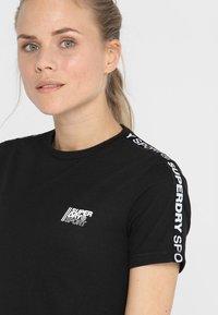Superdry - CORE CROP BRANDED TEE - Print T-shirt - black - 4
