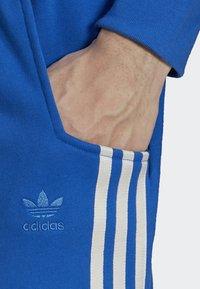 adidas Originals - NINJA PANT UNISEX - Tracksuit bottoms - blue - 4