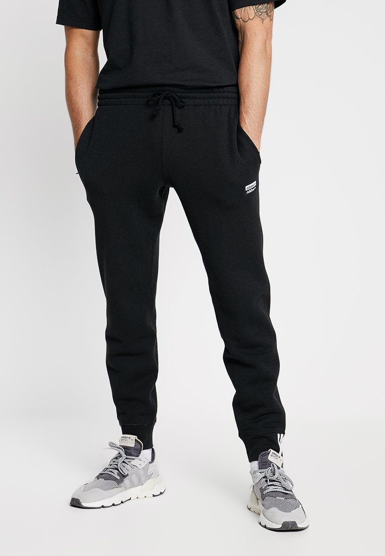 adidas Originals - REVEAL YOUR VOICE - Pantalones deportivos - black