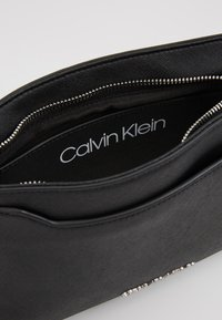 Calvin Klein - TASK XBODY - Across body bag - black