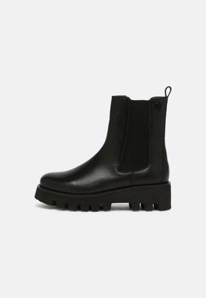 HYRIA - Platform ankle boots - black