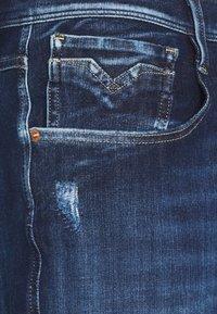 Replay - ANBASS HYPERFLEX BROKEN&REPAIR - Slim fit jeans - dark blue - 2