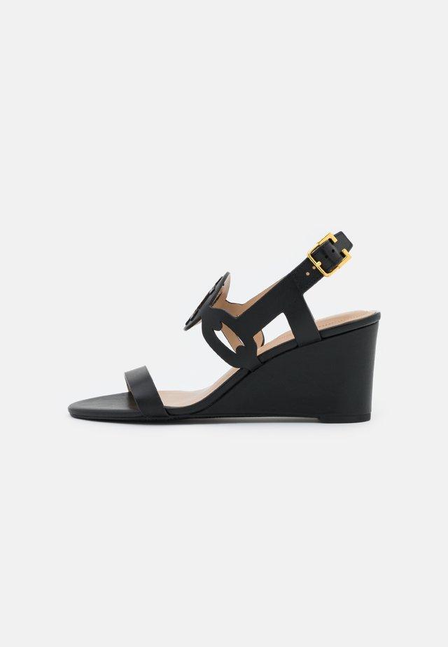 AMILEA - Wedge sandals - black