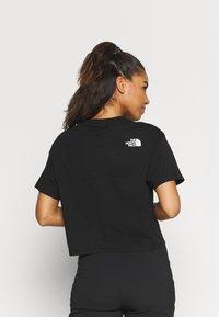 The North Face - CROP TEE - Camiseta estampada - black - 2