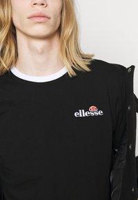 Ellesse - MEDUNO TEE - T-shirt imprimé - black - 4